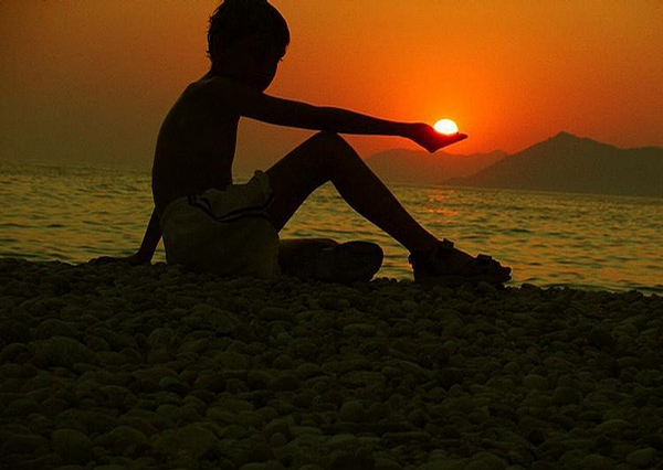 Boy Holding Sun picture