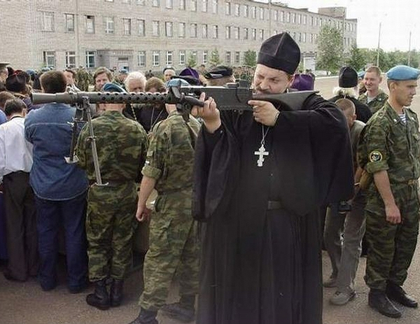 Priest with Gun picture