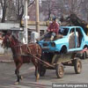 Cart carrying a blue automobile images funny