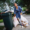Funny pictures images celebrity posing in pyjamas at a garbage bins