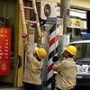 short ladder? No problem for chinese workers