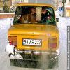 Funny pics com Milka squashed into a car
