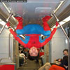 Goofy photos spiderman travelling by tube