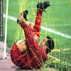 Funny soccer pictures goalie tangled in net
