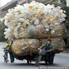 Check out what can fit onto a bike - massiv load of pet bottles funny