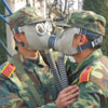 soldiers are joking with gas masks