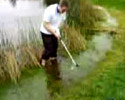 some dude tries to hit the ball in water