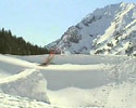 skier jumps into the huge pile of snow