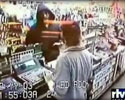 video of robber hitting shop assistant to the face.