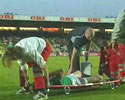 a medic has problems with injured footballist.