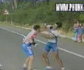 funny windmill fight between two skinny bicyclist.