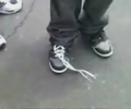 this dude can do up his boot laces with no hands